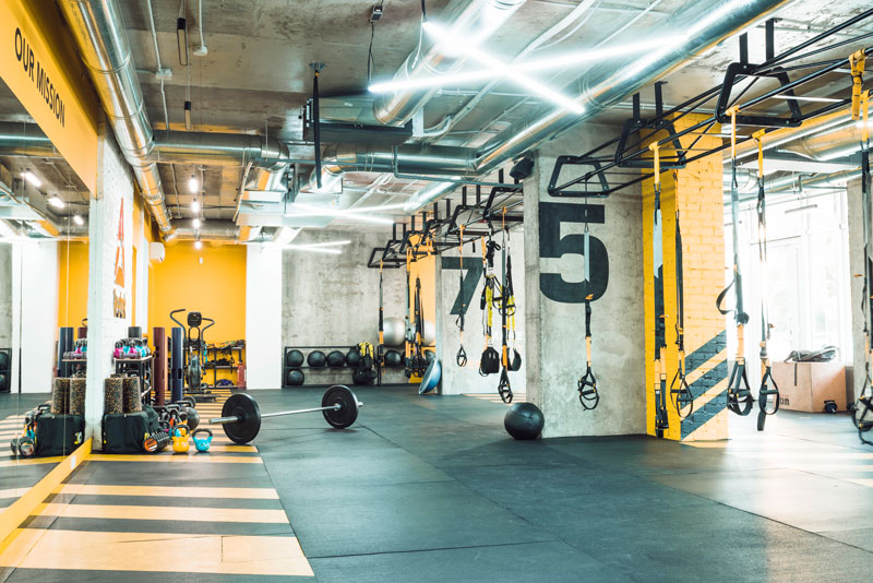 modern gym interior with exercise equipments